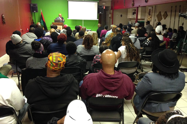 Delxino speaking to the audience at the Buy Black Movement presentation